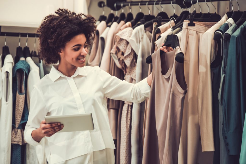 How are legacy fashion companies using technology to adapt to new trends?