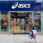 Asics has apologised after pornography was played on giant TV screens facing a busy high for nine-hours at its flagship store in Auckland.