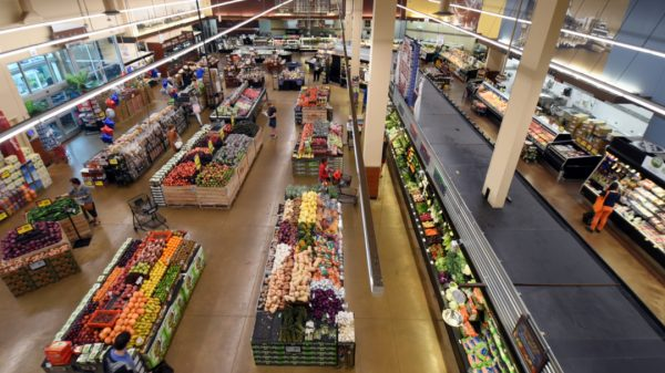 UK supermarkets are increasingly converting shop floor space into areas for online order fulfilment in their largest branches as rents continue to rise.