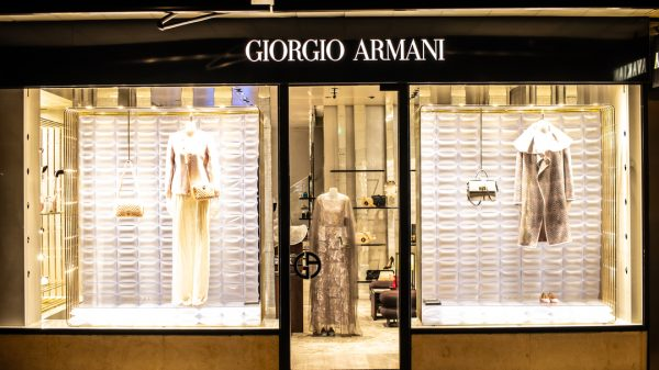 Armani and Yoox Net-a-Porter have launched a new joint initiative which will allow customers in physical Armani stores to shop its entire collection digitally.