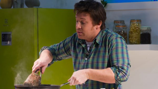 Tesco and Jamie Oliver have launched an online training scheme to train hundreds of community cooks working across the UK's food banks and charity kitchens.