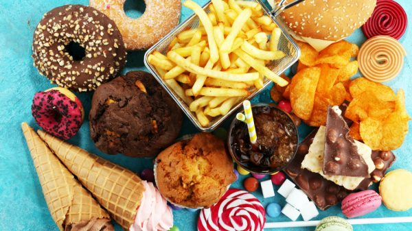 "Food retailers and business groups have slammed government plans to impose a blanket ban on ""junk food"" advertising across all social media and online platforms."