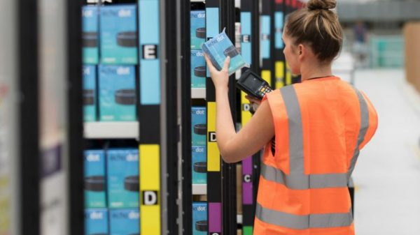 Amazon's warehouses are seeing a spike in COVID-19 cases according to a number of workers while the company pushes ahead with plans to scrap onsite testing and relax mask rules.