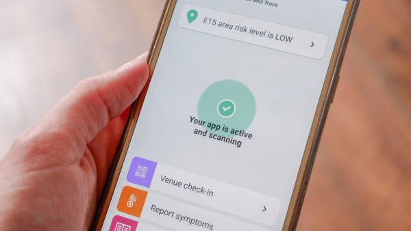 Retailers have warned of severe staff shortages after more than half a million people were 'pinged' by the NHS app and forced to self-isolate in a single week.