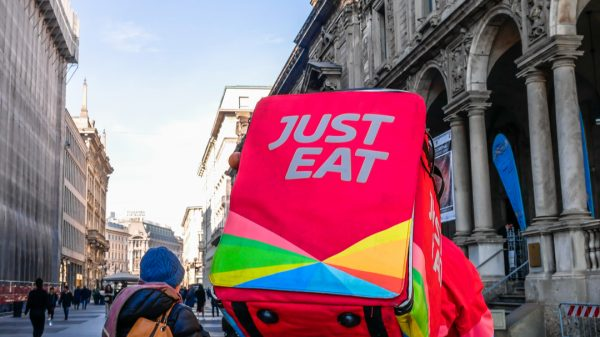 Just Eat Takeaway.com's largest shareholders has warned the food delivery group to prop up the company's share price otherwise it will endure a hostile takeover.