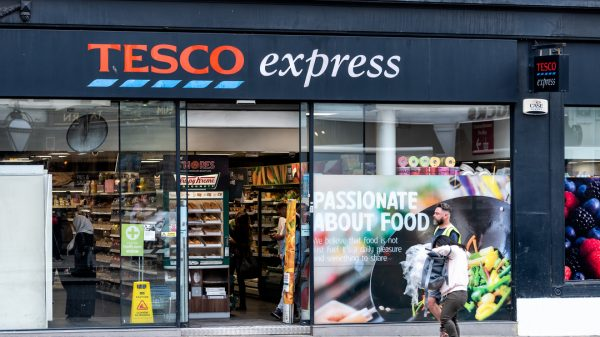 Tesco has readied one of its express stores in central London to offer 'just walk out' technology in a bid to rival smart grocer Amazon Fresh.