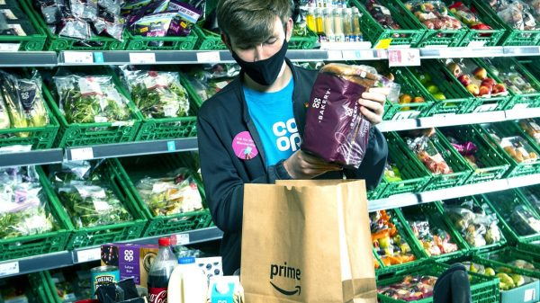 Amazon has significantly increased its influence over the UK's grocery market as Co-op becomes the third major supermarket to sell its goods via its website.