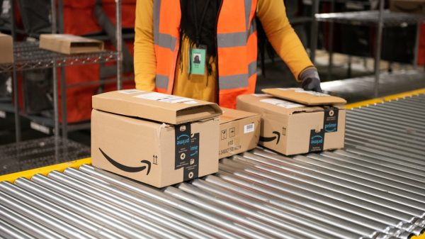 Amazon is offering UK warehouse staff a £50 weekly bonus if they turn up to work on time, as it continues its struggle to retain workers.