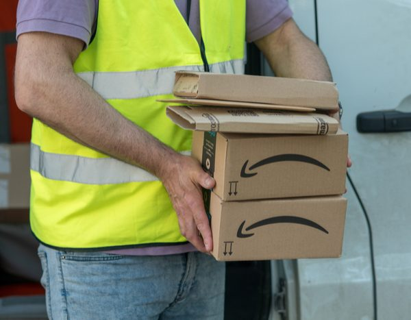 Amazon has gifted eight of its fully vaccinated warehouse workers free cars and $100,000 in cash in a bid to encourage employees to get their Covid-19 jab.