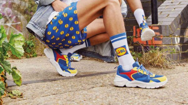 Lidl is launching its wildly popular range of own branded merchandise in the UK including trainers, socks shorts and tote bags.