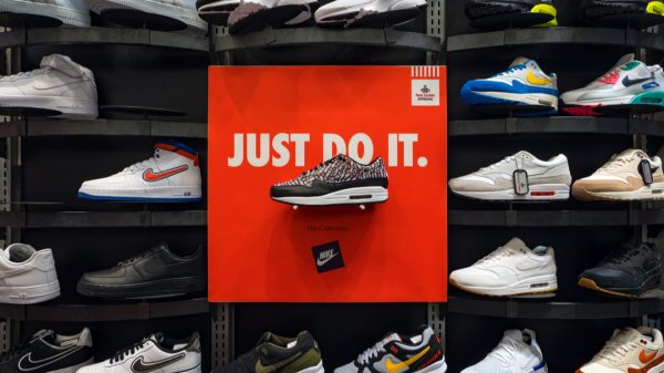 """Nike's shares have sunk three per cent after it warned investors that it will take """"several months"""" for production to return to normal amid continued chaos in Vietnam."""